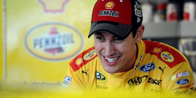KANSAS CITY, KS - OCTOBER 14: Joey Logano, driver of the #22 Shell Pennzoil Ford, stands in the garage area during practice for the NASCAR Sprint Cup Series Hollywood Casino 400 at Kansas Speedway on October 14, 2016 in Kansas City, Kansas. (Photo by Rainier Ehrhardt/NASCAR via Getty Images)