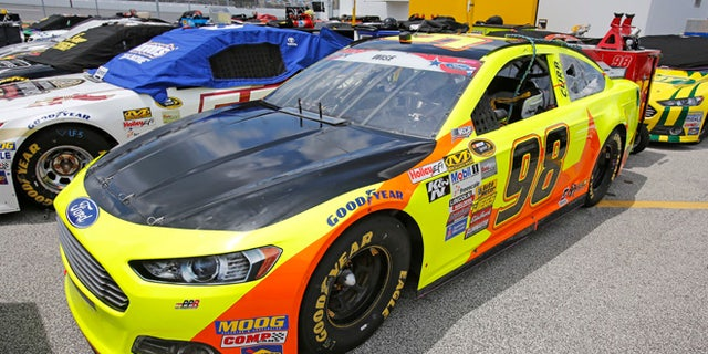 July 4, 2014: Josh Wise's car has a black-painted hood to cover a campaign ad for Florida Democratic gubernatorial candidate Charlie Crist before NASCAR Sprint Cup series qualifying at Daytona International Speedway in Daytona Beach, Fla. (AP)