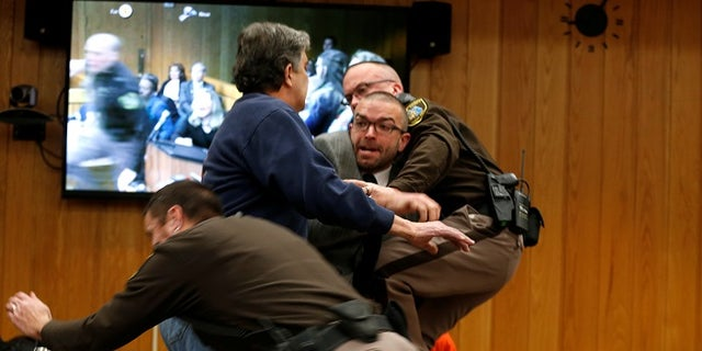 Randall Margraves was subdued after he attempted to lunge at Larry Nassar.