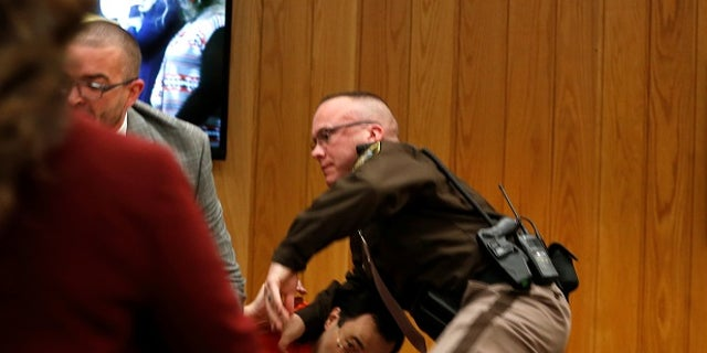 Larry Nassar ducked as Randall Margraves attempted to attack him.