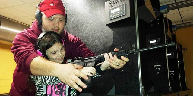 Natalie Gibson practices her shot with father Nathan.