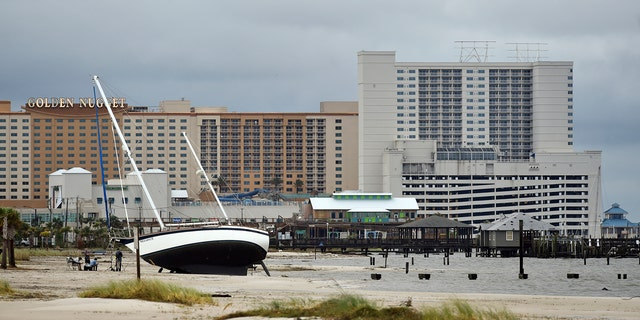 A sail boat is beached near Margaritaville and the Golden Nugget in Biloxi, Miss., Sunday, Oct. 8, 2017, after Hurricane Nate made landfall on the Gulf Coast