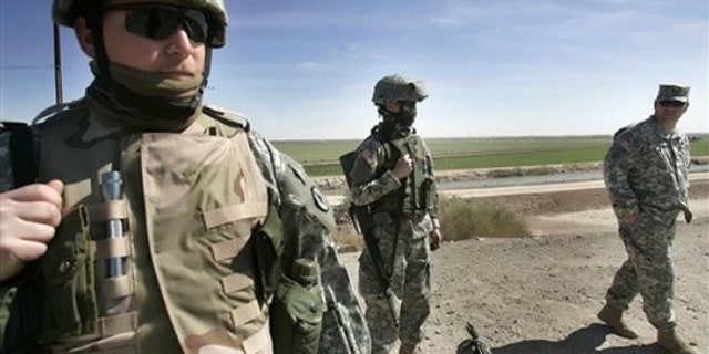 In this March 2, 2007 file photo, Tennessee National Guard Sgt. Phillip Williams of Gatlinburg stands guard near the Mexican border in Yuma, Ariz. (AP)