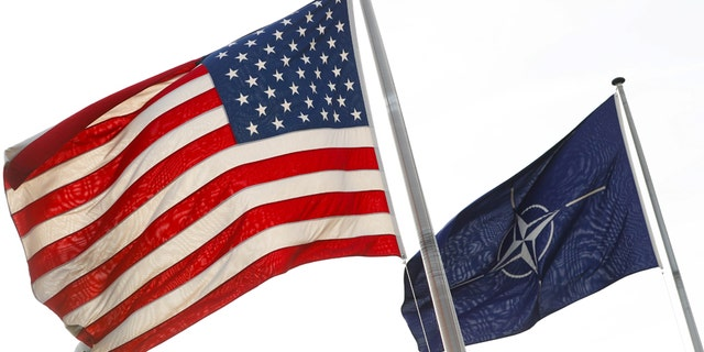 March 31, 2017: NATO and U.S. flags fly at the entrance of the Alliance's headquarters during a NATO foreign ministers meeting in Brussels, Belgium.