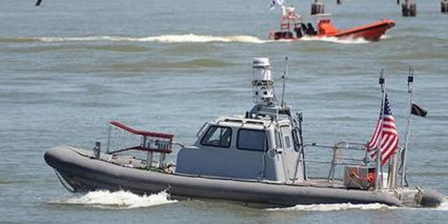 During a recent Navy exercise, unmanned boats, such as this rigid hulled inflatable boat, swarmed a simulated enemy without humans controlling them.