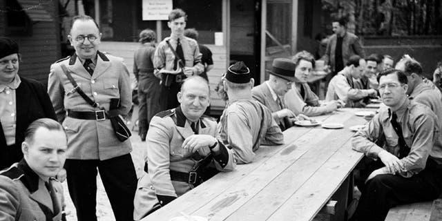 Members of the German American Bund pose for a photo at Camp Siegfried, in Yaphank, N.Y., in 1938.
