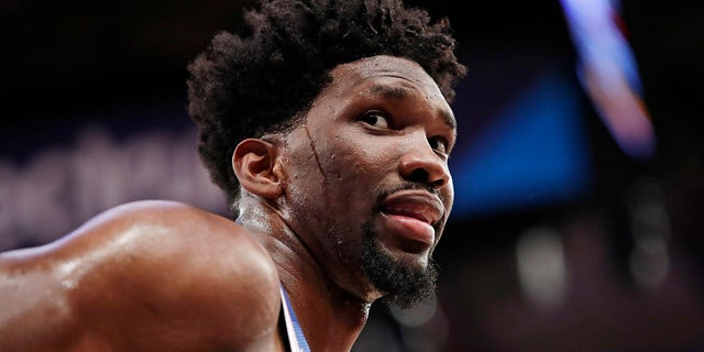 Philadelphia 76ers' Joel Embiid (21) talks to spectators during the second half of the team's NBA basketball game against the New York Knicks in New York.