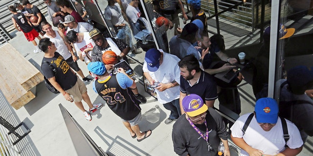 Los Angeles Lakers fans were already waiting in line around noon for promised free pizza that would be handed out between 2 and 5 p.m.