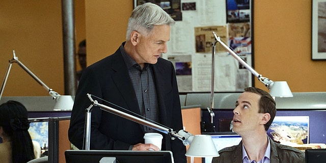 """""""Loose Cannons"""" -- Dinozzo pays Jeanne Benoit (Scottie Thompson) a visit as he chases a lead involving doctors in Sudan, on NCIS, Tuesday, Feb. 23 (8:00-9:00 PM, ET/PT), on the CBS Television Network. Pictured left to right: Mark Harmon and Sean Murray  Photo: Cliff Lipson/CBS ©2016 CBS Broadcasting, Inc. All Rights Reserved"""