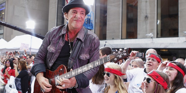 Guitarist Neal Schon performs with the band Journey on NBC's Today Show in New York July 29, 2011.