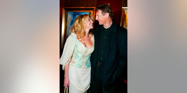 """December 8, 2002. Natasha Richardson and her husband, actor Liam Neeson, arrive at the world premiere of the film, """"Maid in Manhattan,"""" in New York City."""