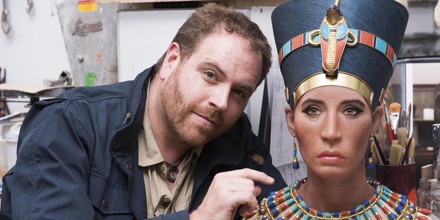 Josh Gates with the bust of Queen Nefertiti.