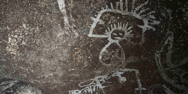 A depiction of a man rubbed into a Mona Island cave wall at least 500 years ago.