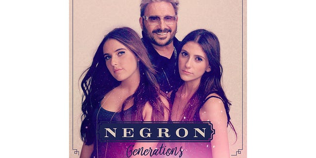 Chuck Negron with his daughters.