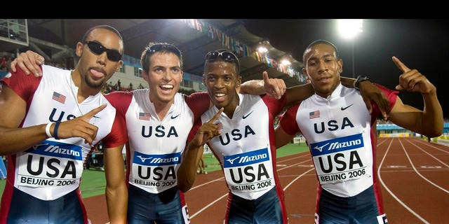 From left United State's Quentin Summers, Chris Carter, Justin Oliver and Bryshon Nellum pose for photographs after winning the final of the Men's 4x400 Meters Relay event of the IAAF Track and Field World Junior Championships held in Beijing, China, Sunday, Aug 20, 2006. The United States team clinch the gold medal with a time of 3:03.76 minutes. (AP Photo/Ng Han Guan)