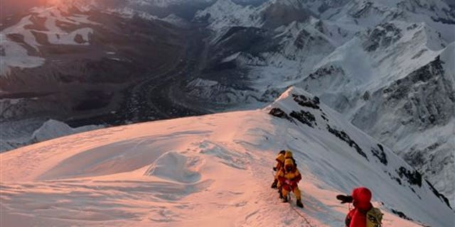 In this May 18, 2013 file photo released by mountain guide Adrian Ballinger of Alpenglow Expeditions, climbers make their way to the summit of Mount Everest, in the Khumbu region of the Nepal Himalayas.