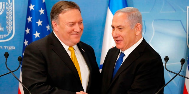 In this Sunday, April 29, 2018 file photo, U.S. Secretary of State Mike Pompeo (left) is greeted by Israeli Prime Minister Benjamin Netanyahu ahead of a press conference at the Ministry of Defense in Tel Aviv.