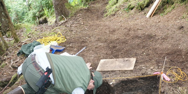 An archaeologist working at the site of the camp used by survivors of The Neva