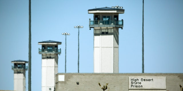 FILE - April 15, 2016: Guard towers are seen at High Desert State Prison in Indian Springs, Nev.