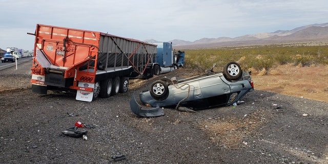 Two men from Idaho were ejected from a Toyota Corolla after it was struck by the semi-truck and died at the scene, police say.