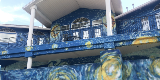 """When Vincent Van Gogh's iconic 1889 painting """"Starry Night"""" was recreated on the home last July, Mount Dora officials called it an eyesore. The city slapped the homeowners with a graffiti violation and $3,100 fine, then charged them $100 a day, up to the value of the house, until the mural was painted over. They were given 30 days to comply or faced steeper fines."""