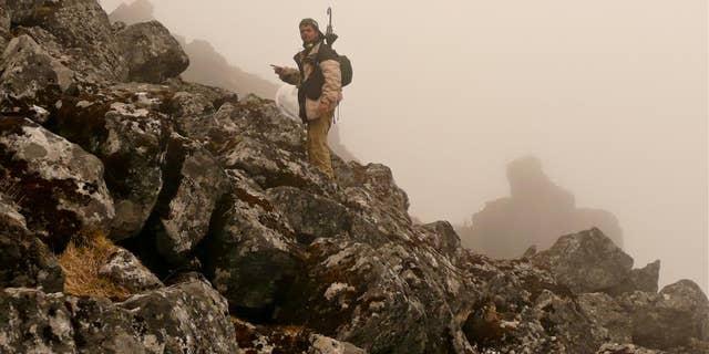 Co-author Shashank Dalvi looking for thrushes 4200 m, Sela Pass, West Kameng, India, June 2009.