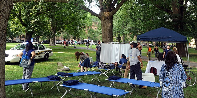 Cots were set up Thursday as a makeshift treatment center on the New Haven Green to handle the drug overdoses.