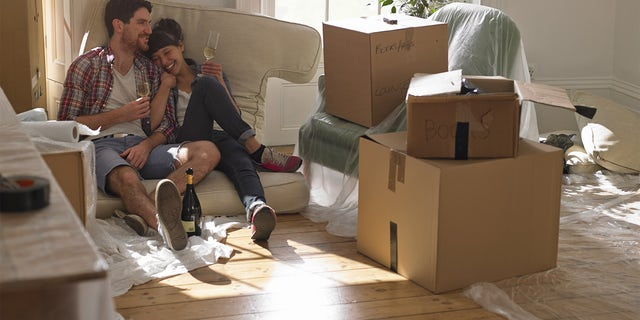 couple moving in to new house, drinking champagne