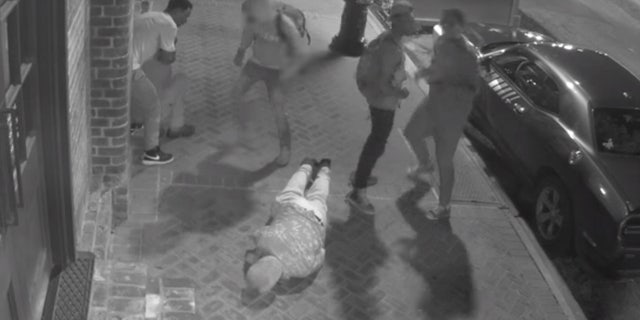 Surveillance video shows the violent robbery of two tourists in New Orleans' famed French Quarter.  (New Orleans Police Department)