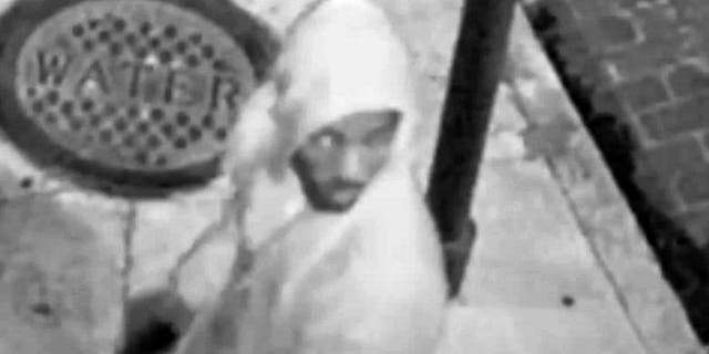 Image from surveillance video shows hooded man in shooting of a Good Samaritan trying to help a mugging victim. (NOPD)