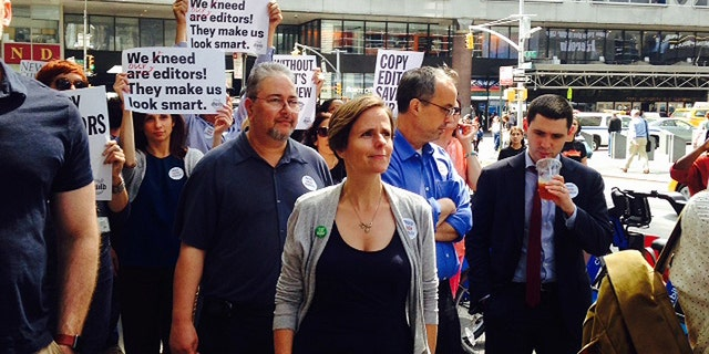 Journalists at the New York Times staged a brief demonstration outside their office Thursday to protest planned cuts to the newspaper's copy editing staff.