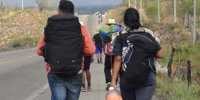 Central American migrants arrive in Ixtepec, Oaxaca, Mexico, before continuing their journey to the U.S.
