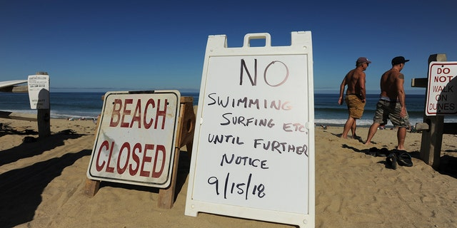 Officials placed signs telling visitors beaches were closed following Medici's death.