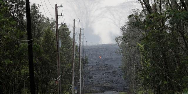 The Kilauea lava flow cuts off Kahukai Street, in the Leilani Estates near Pahoa, Hawaii, U.S., May 29, 2018.