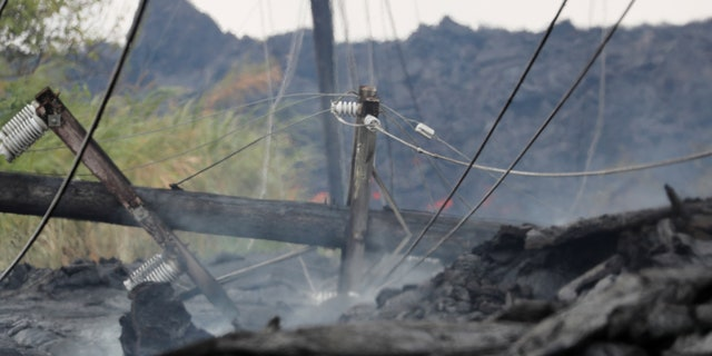 Utility poles and power lines sit destroyed in the Kilauea lava flow on Pohoiki Road near Pahoa, Hawaii, U.S., May 29, 2018.
