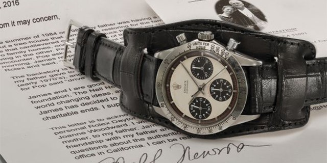 The stainless steel watch features a crocodile strap and can be seen in countless photos of Newman.