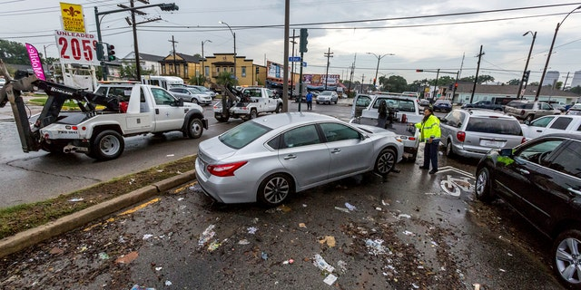 Flooded cars are cleared from Orleans Avenue at Broad Street in Mid City.