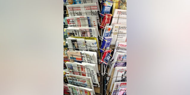File photo - Newspapers and magazines are seen in a kiosk in Paris, France, April 22, 2016. (REUTERS/Charles Platiau)