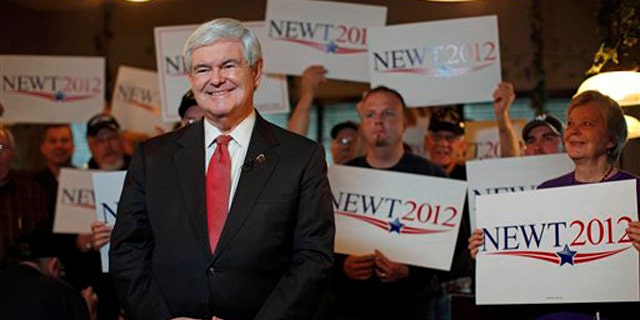 Republican presidential candidate and former House Speaker Newt Gingrich takes part in a TV interview during a campaign event at the Grapevine Restaurant in Spartanburg, S.C., on Saturday, Jan. 21, 2012, the unpredictable voting day of the South Carolina presidential primary. (AP Photo/Matt Rourke)