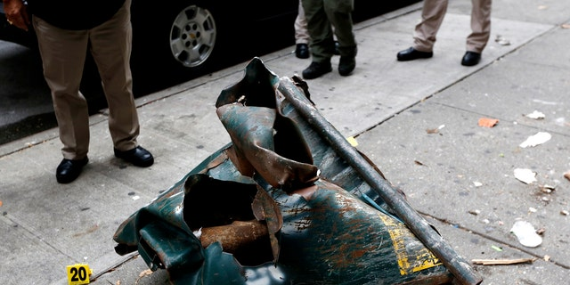 A view of a mangled dumpster at the site of an explosion that occurred on Saturday night in the Chelsea neighborhood of New York, USA, Sept. 18, 2016. (REUTERS/Junstin Lane/Pool)