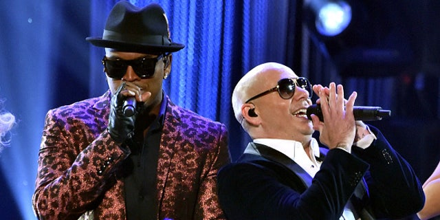 LOS ANGELES, CA - NOVEMBER 23:  Recording artist Ne-Yo (L) and host Pitbull perform onstage at the 2014 American Music Awards at Nokia Theatre L.A. Live on November 23, 2014 in Los Angeles, California.  (Photo by Kevin Winter/Getty Images)