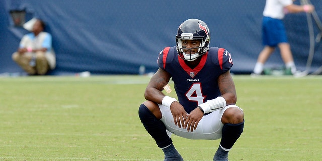 Houston Texans quarterback Deshaun Watson pauses on the field after time ran out in the fourth quarter and the Texans' final drive ended in an NFL football game against the Tennessee Titans.