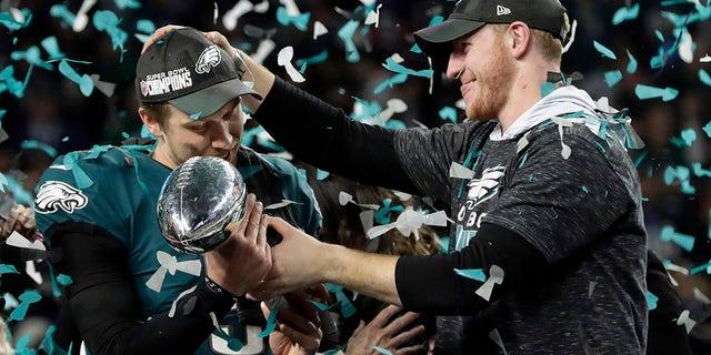 Eagles quarterbacks Nick Foles and Carson Wentz celebrate.