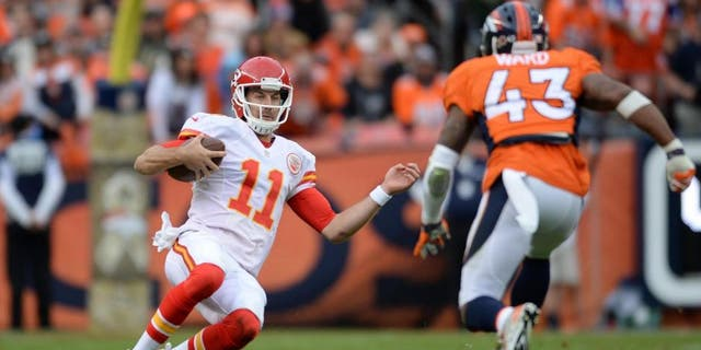 Nov 15, 2015; Denver, CO, USA; Kansas City Chiefs quarterback Alex Smith (11) slides as Denver Broncos strong safety T.J. Ward (43) closes in in the second quarter at Sports Authority Field at Mile High. Mandatory Credit: Ron Chenoy-USA TODAY Sports