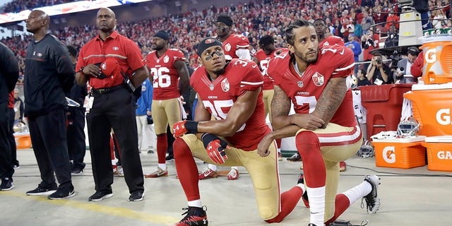 Colin Kaepernick and Eric Reid kneeling during the national anthem during the 2016 season.