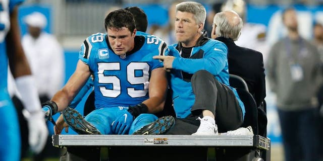 Carolina Panthers middle linebacker Luke Kuechly (59) rides the cart after an injury in the fourth quarter against the New Orleans Saints at Bank of America Stadium. The Panthers defeated the Saints 23-20. (Jeremy Brevard-USA TODAY Sports)