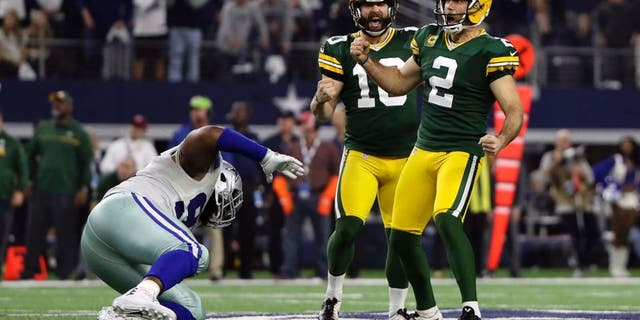 Jan 15, 2017; Arlington, TX, USA; Green Bay Packers kicker Mason Crosby (2) celebrates making a field goal in the NFC Divisional playoff game against the Dallas Cowboys at AT&T Stadium. Mandatory Credit: Kevin Jairaj-USA TODAY Sports