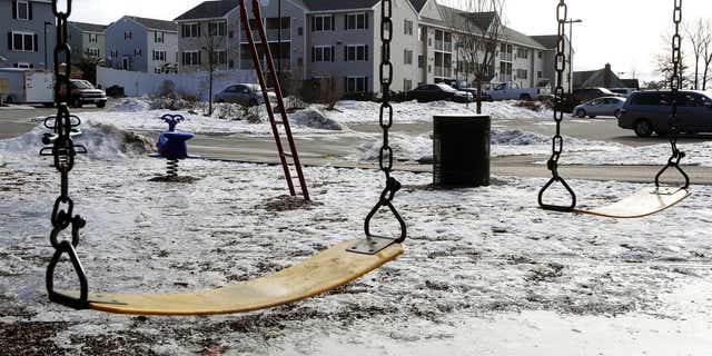 Jan. 22, 2015: An empty playground is seen at an apartment complex in Manchester, N.H.
