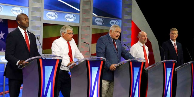 Republican hopefuls for New Hampshire's 1st Congressional District, from left to right, Eddie Edwards, Michael Callis, Andy Martin, Jeffory Denaro and Andy Sanborn participate in a debate at St. Anselm College in Manchester, N.H.,  Sept. 6.