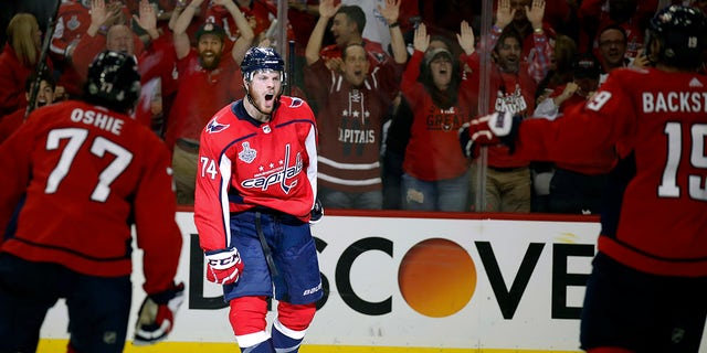 Washington Capitals defenseman John Carlson, center, celebrates with teammates after scoring a goal against the Vegas Golden Knights during the second period in Game 4 of the NHL hockey Stanley Cup Final.